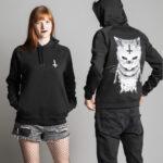 C'est un sweat à capuche noir femme et homme de la marque Radio Metal qui représente un chat satanique
